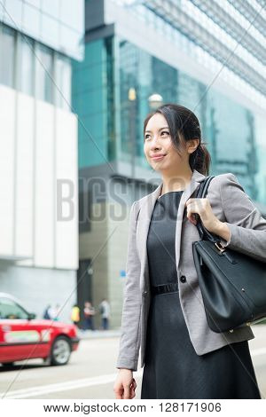 Young business woman walking at outdoor