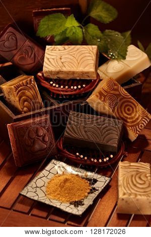 Closeup photo of natural soap bars in wooden box.