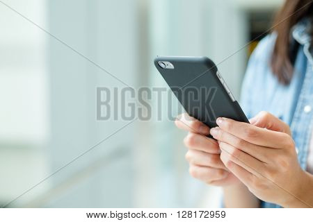 Woman use of cellphone at indoor