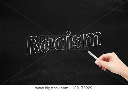 Racism written on a blackboard