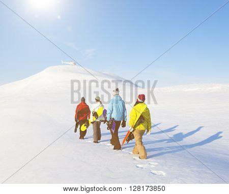 Group of snowboarders enjoying a beautiful Winter morning.