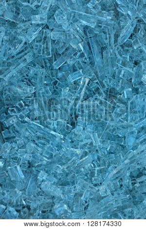 Blue background of little fragments of a shattered glass