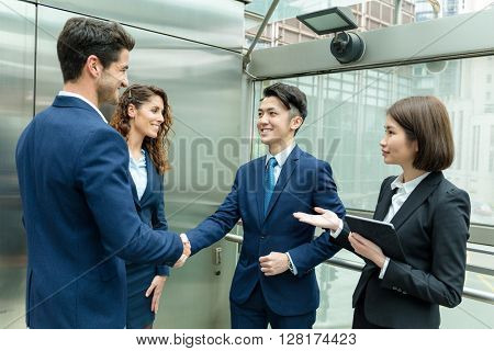 Business people hand shaking