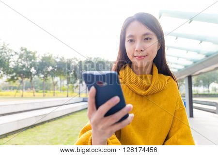 Woman texting on cellphone