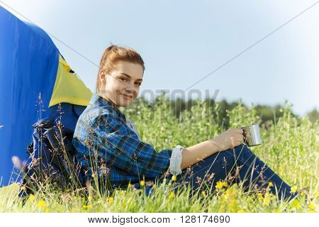 Woman hiker in summer forest