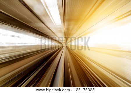 Speed blur railway track at station