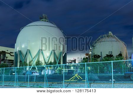 Gas storage tank at night