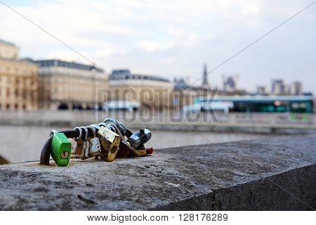 Paris, France - February, 8, 2016: veiw of locks on a Seine River Embankment parapet in Paris, France