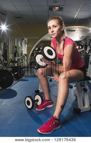 beauty sporty blonde woman in gym