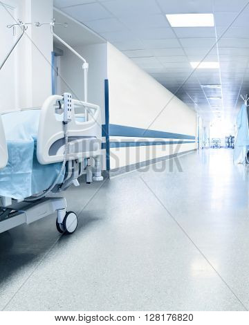 Surgical bed in hospital's corridor near operation room. Tinted picture