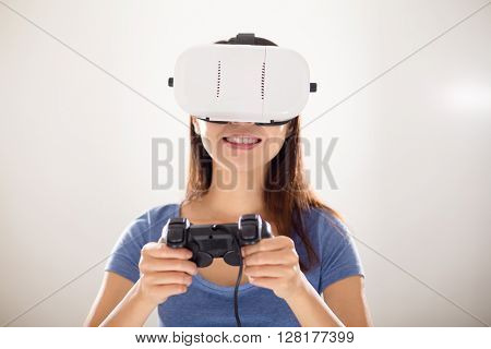 Woman play video game wearing virtual reality headset