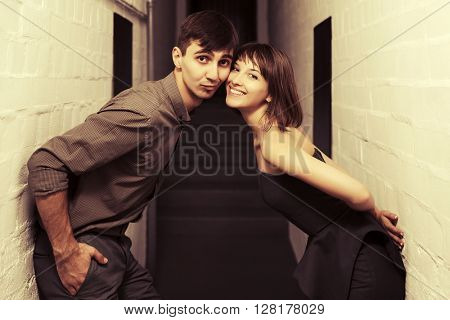 Happy young couple in love at apartment. Male and female fashion model indoors