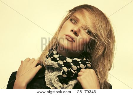 Portrait of sad young fashion woman outdoor. Female blond fashion model against a sky
