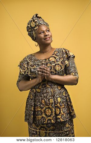 African American female mature adult in African dress.