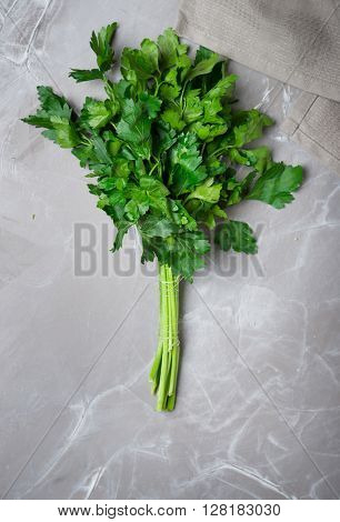 Fresh green parsley on a gray concrete background