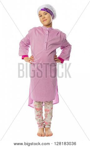 Little girl in traditional muslim clothes isolated