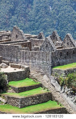 stairs and ancient houses to Machu Picchu