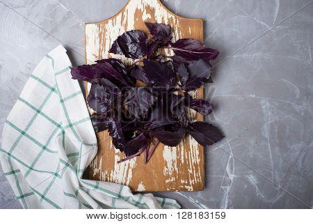 Fresh red basil on a wooden cutting board