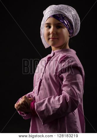 Little girl in traditional muslim clothes