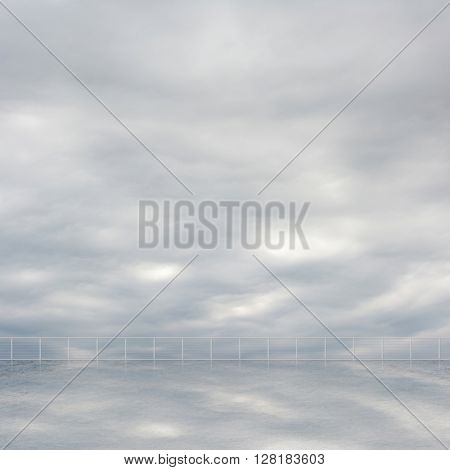 Background of clouds and reflection on the ground of a roof of building with nobody.