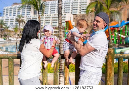 Happy family with twins on summer holidays in Spain