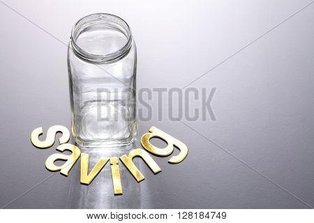 empty saving jar with alphabets saving