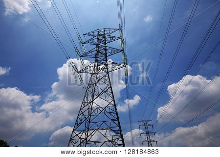 electric high voltage power on blue sky