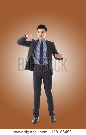 Holding pose of Asian business man, full length isolated.