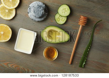Still life with avocado oil on wooden background