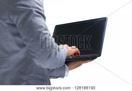 Handsome businessman holding a laptop
