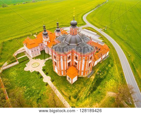 Aerial view of Marianska Tynice - The Pilgrimage Church of the Annunciation of Our Lady. Baroque architecture in agricultural landscape. Beautiful landmark in Czech Republic, Europe.