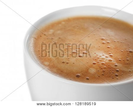 A cup of tasty creamy coffee, isolated on white, close-up