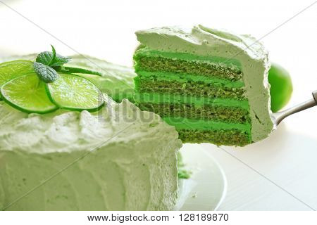 Slicing tasty lime cake close up