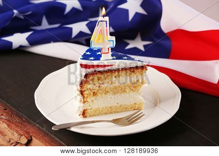 Piece of American flag cake, on black wooden table. Fourth of July day concept.