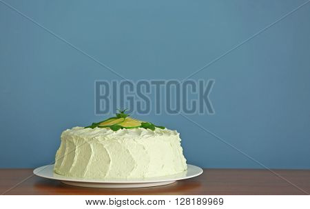 Lime cake on wooden table