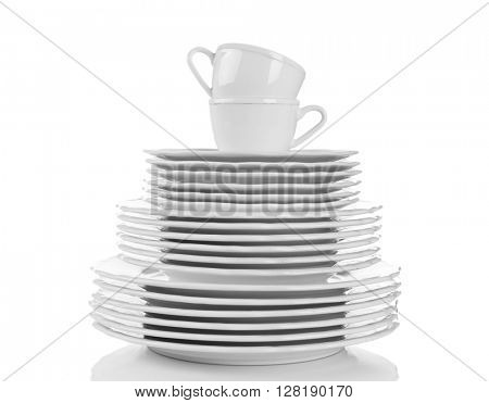 Stacked white clean plates and cups isolated on white