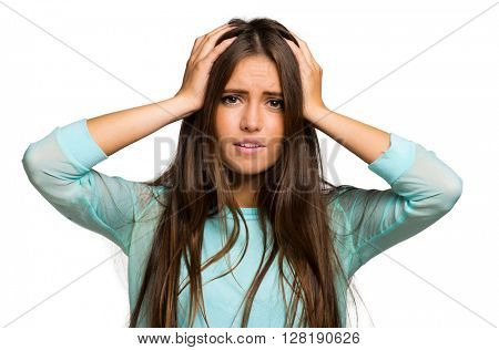 Portrait of a desperate young woman pulling her hair