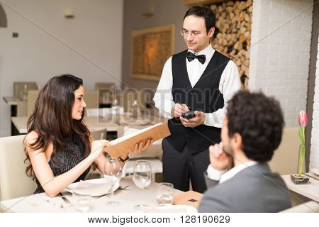 Couple ordering dinner in a luxury restaurant