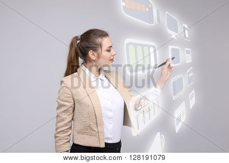 Woman pressing high tech type of modern multimedia buttons on a virtual background