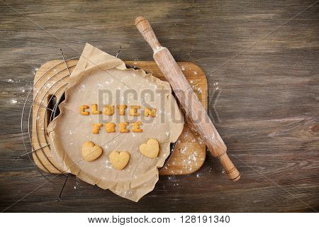 Gluten free made of crackers on parchment over wooden table