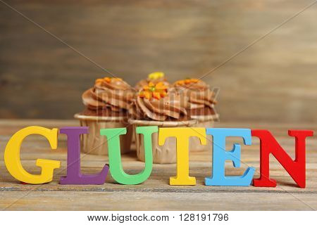 Gluten Free cupcakes on wooden background, close up