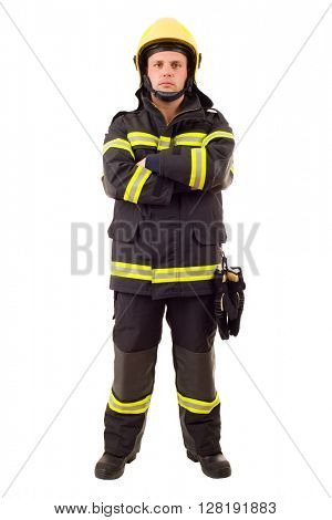 Serious firefighter posing with arms crossed. Full length studio shot isolated on white.