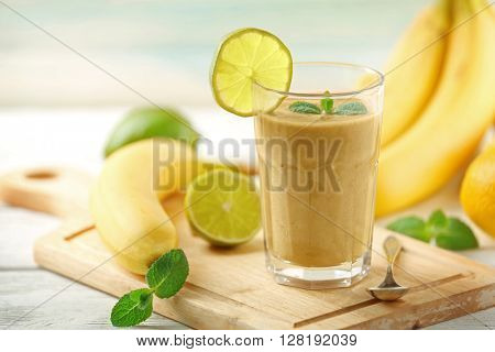 Fresh banana cocktail with fruits on cutting board