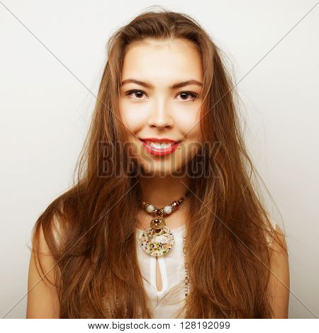 Beautiful young surprised woman. Studio shot.