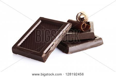 Slice and chips of chocolate, isolated on white
