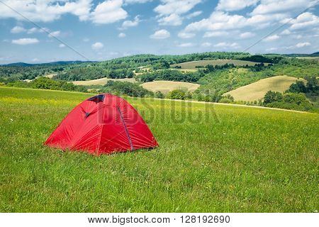 Tent on a green field