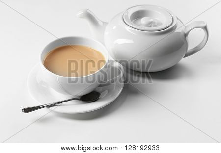 Milk tea with tea pot on white background