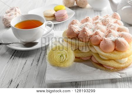 Cup of tea with delicious cakes
