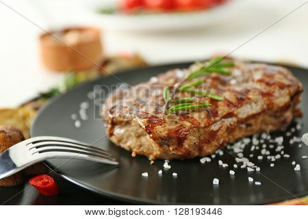 Delicious grilled steak, closeup