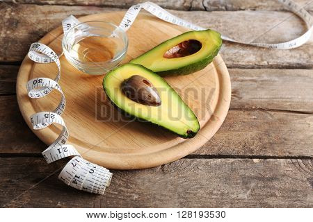 Fresh avocados  on wooden board, close up
